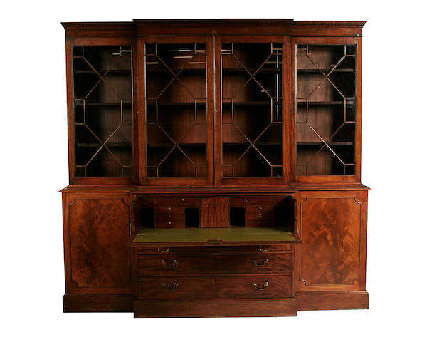 A George III and later mahogany breakfront secretaire library bookcase