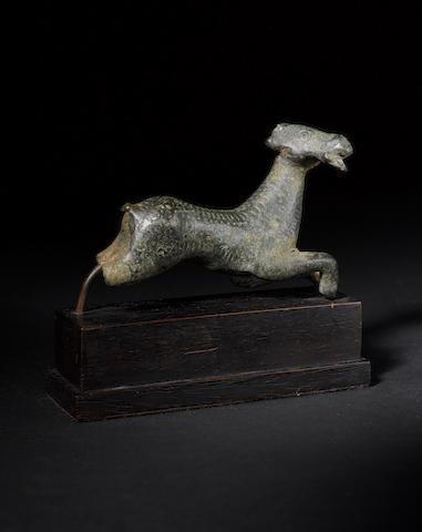 A bronze running goat