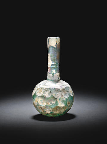 An early Islamic wheel-cut glass bottle