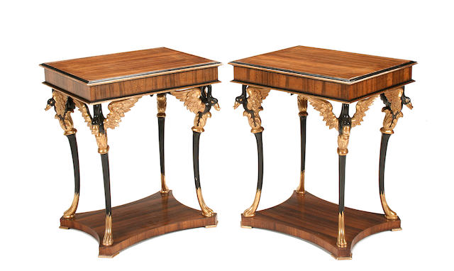 A pair of Empire style rosewood and parcel giltwood side tables