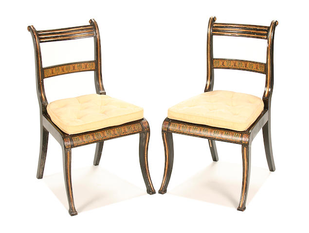 A pair of Regency painted and parcel gilt side chairs