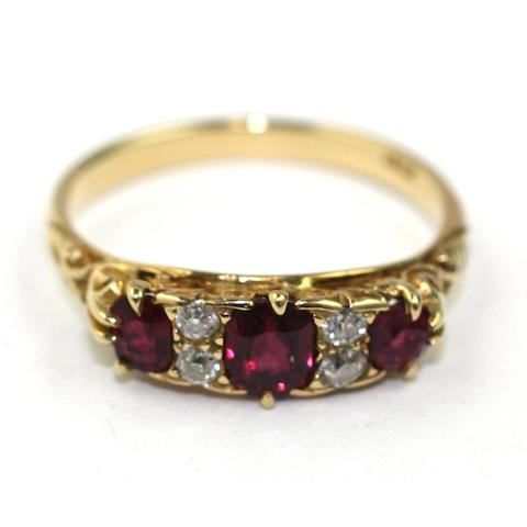 A diamond and ruby seven stone ring