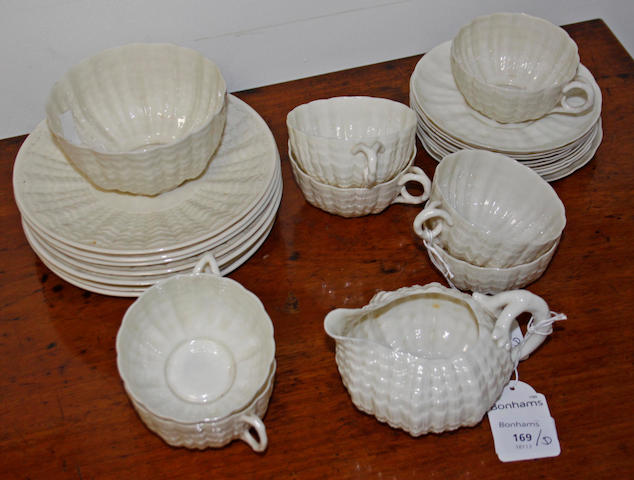A Belleek porcelain part tea service, in white pearlescent glaze comprising:- 7 cups, 9 saucers, 8 side plates, milk jug and sugar basin.