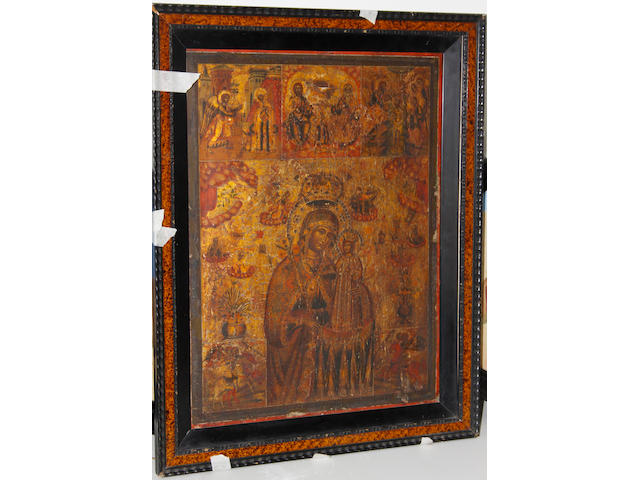 A Russian painted Icon, Mother of God Iverskaya - crowned on a gold ground panels of Saints above and at the corners, on wood panel, 51 x 38cm.