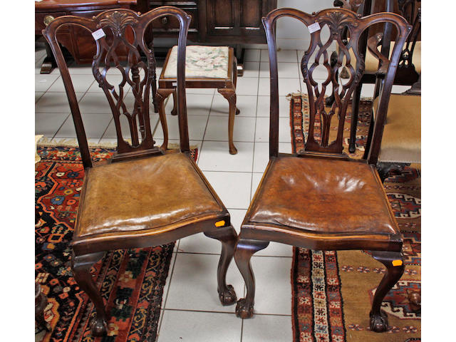 A set of twelve Chippendale style carved mahogany dining chairs