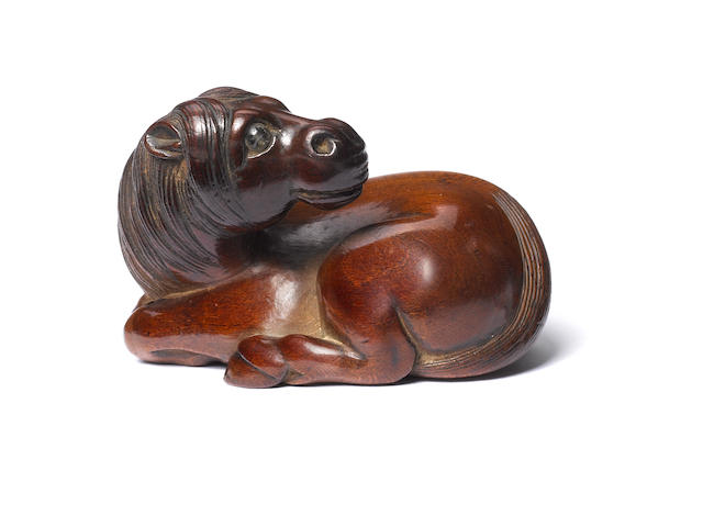 A wood netsuke of a recumbent horse Early 19th century