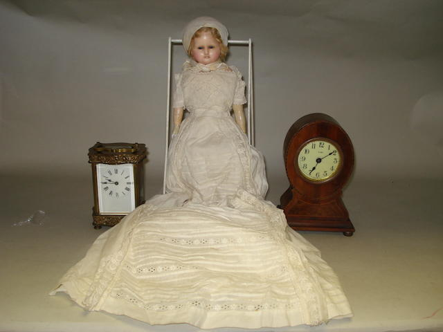 A French carriage clock, a mantle clock and a wax headed doll.