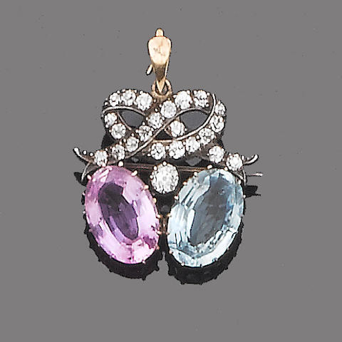 An early 20th century pink topaz, aquamarine and diamond brooch/pendant,