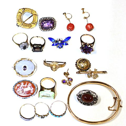 A collection of jewellery, to include: three single stone dress rings, a pair of red coral ear pendants, an amethyst and split pearl brooch, hollow gold snap bangle, pair of amethyst set ear studs, enamel fly brooch, five various brooches, a sapphire and diamond cluster ring, diamond set ring, stone lacking, two other rings, and a small stone set Arts & Crafts style brooch.