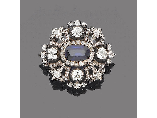A sapphire and diamond cluster brooch/pendant,