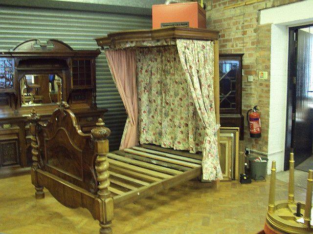 A mid-Victorian mahogany 5ft half-tester bed