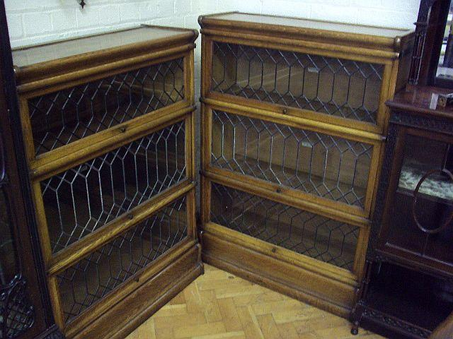 A near pair of light oak Globe Wernicke stacking bookcases, early 20th Century Each bearing ivorine 'Globe Wernicke Co. Ltd' label