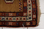 A Tekke Hatchli,137 x 117cm, a Milas rug in yellow-brown and ivory, 193 x 117cm and a Kurdish runner with ten guls on a camel ground, 322 x 100cm and a Belouchi rug. (4)