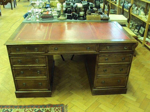 A large mahogany pedestal desk, late 19th Century The drawer stamped 'The Diocesan Registry...Liverpool'