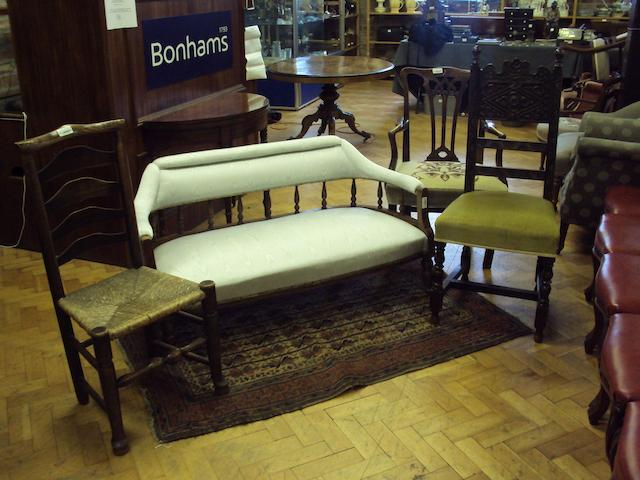 A late Victorian walnut-framed sofa