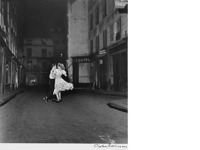Robert Doisneau (French, 1912-1994) La derni&egravere valse du 14 juillet (Last Waltz on Bastille Day), Paris, 1949 Paper 40.3 x 30.1cm (15 7/8 x 11 7/8in), image 27.5 x 24.4cm (11 7/8 x 9 5/8in)