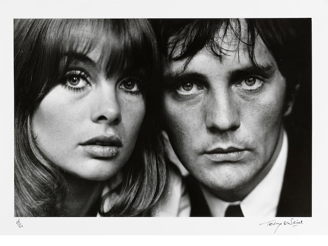 Terry O'Neill (British, born 1938) Jean Shrimpton and Terence Stamp, London, 1963 Paper 40.5 x 50.5cm (16 x 19 7/8in), image 30.4 x 45.6cm (12 x 18in).