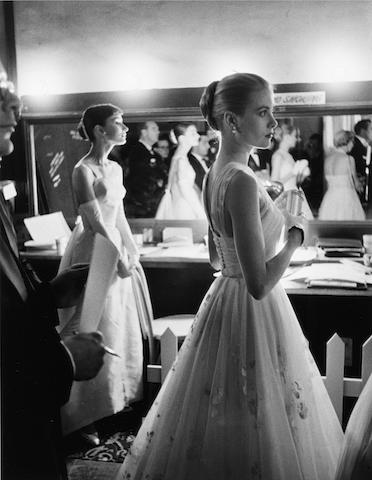 Allan Grant (American, 1920-2008) Audrey Hepburn and Grace Kelly backstage at the 28th Annual Academy Awards, Hollywood, 1956 Paper 50.6 x 40.3cm (20 x 15 7/8in), image 43.8 x 33.6cm (17 1/4 x 13 1/4in).