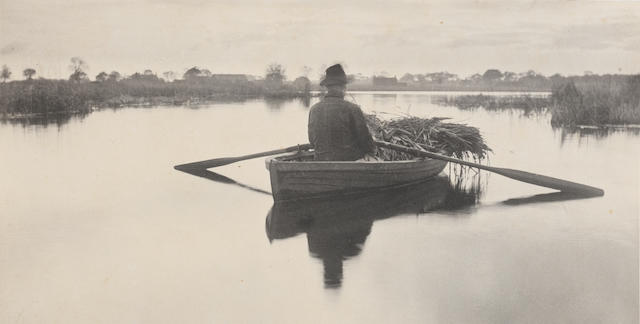 Peter Henry Emerson (British, 1856-1936) Rowing Home the Schoof-Stuff, 1886, Plate XXI from Life & Landscape on the Norfolk Broads  14 x 27.8cm (5 1/2 x 10 15/16in).