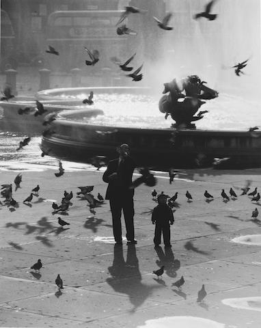 Wolfgang Suschitzky (British, born 1912) Trafalgar Square, London, 1953 Paper 50.6 x 40.6cm (19 7/8 x 16in), image 46.6 x 36.9cm (18 3/8 x 14 1/2in).