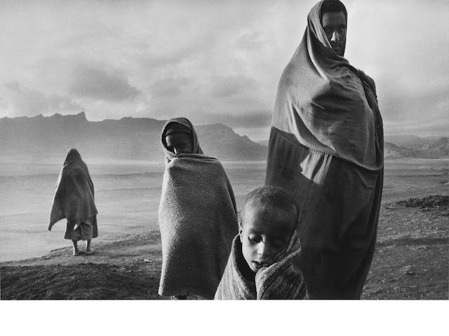 Sebastião Salgado (Brazilian, born 1944) Ethiopia, 1984 Paper 50.8 x 60.6cm (20 x 23 7/8), image 34.2 x 51.9cm (13 1/2 x 20 1/2in.)
