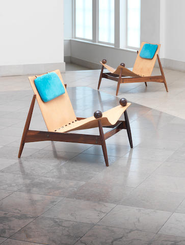A pair of leather armchairs, attributed to Lina Bo Bardi