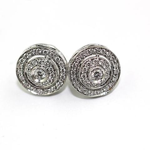 A pair of diamond tiered target cluster earrings