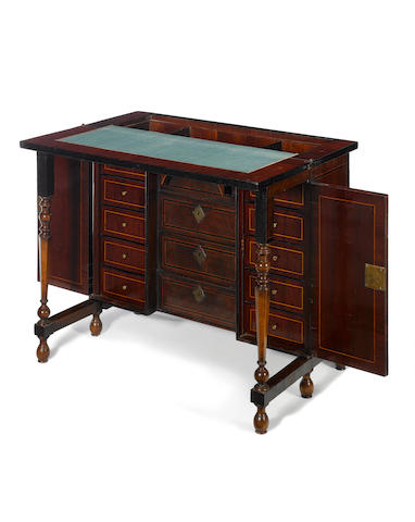 A rosewood, fruitwood and walnut kneehole writing desk