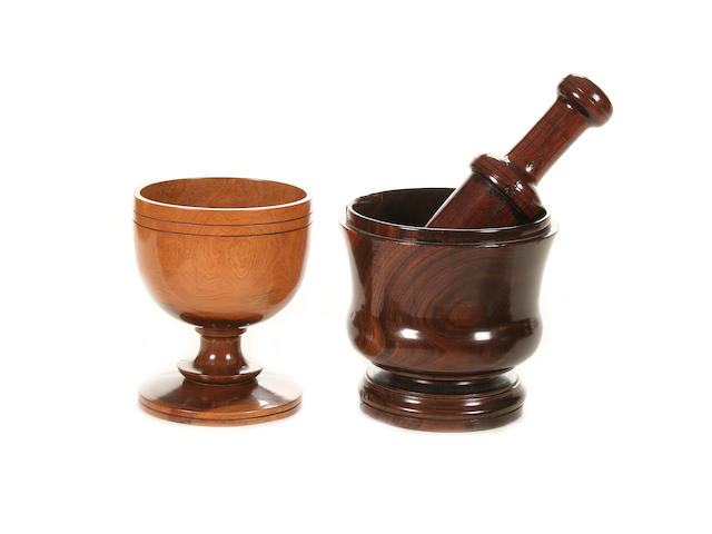 A 19th century lignum vitae pestle and mortar together with a lignum vitae goblet