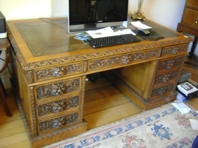 A late 19th century carved oak pedestal desk