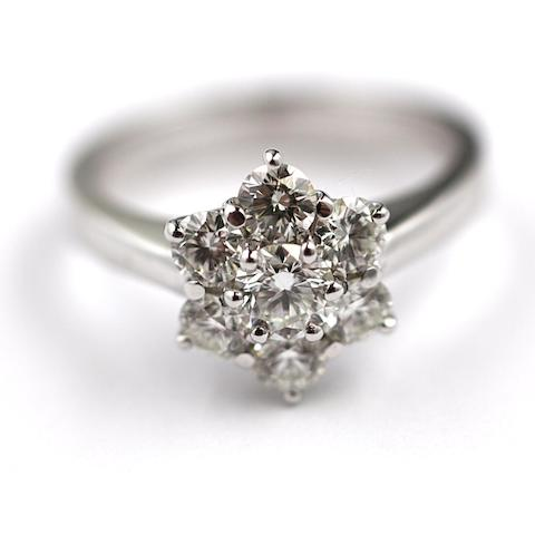 A diamond seven stone flowerhead cluster ring