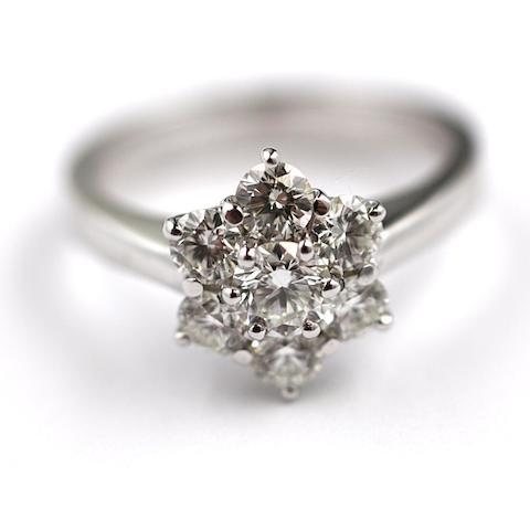 A diamond seven stone flowerhead cluster ring