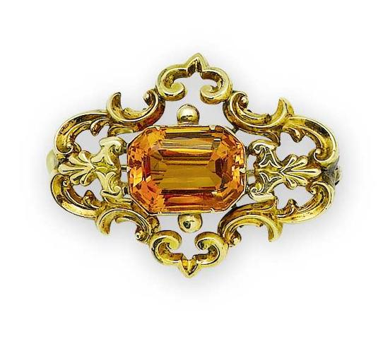 A mid 19th century topaz brooch