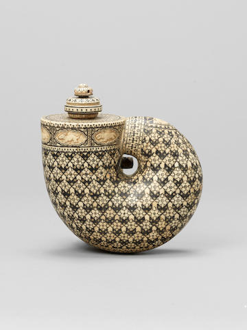 A carved and inlaid ivory Powder Flask Alwar, Rajasthan, late 19th Century