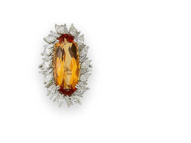 A topaz and diamond cluster ring, by Stern,