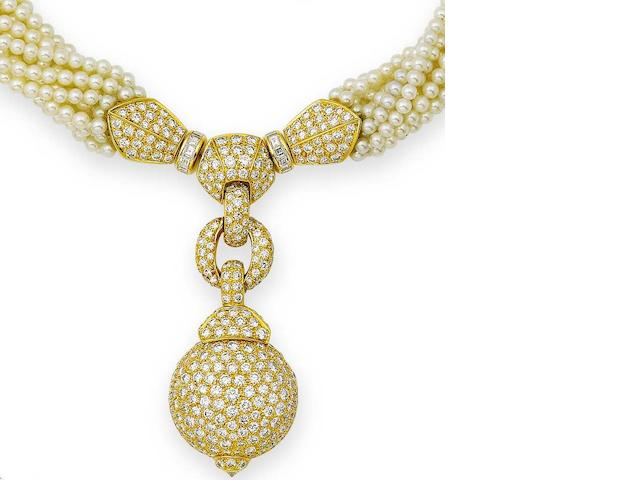 A diamond and cultured pearl necklace, bracelet and earring suite, by Cartier (3)