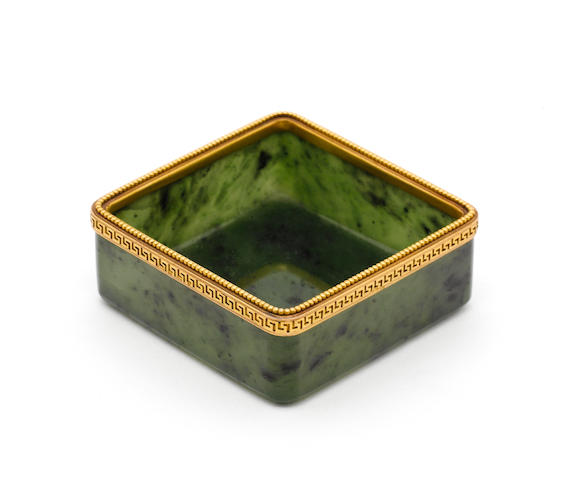 An early 20th century Russian 12 carat gold mounted nephrite dish, maker's mark lost in decoration, with import marks for George Stockwell, London 1928,