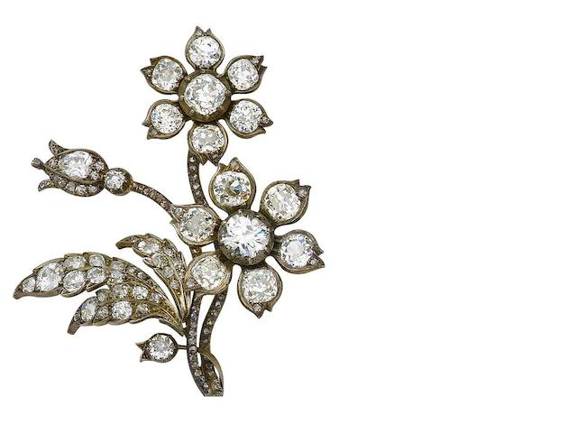 A pair of diamond spray brooches, (2)