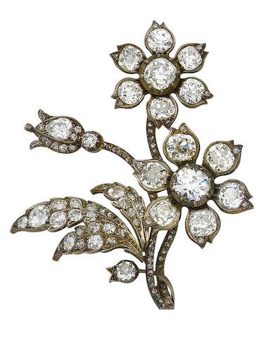 A pair of diamond spray brooches, (2)
