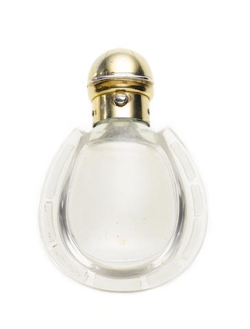 A Victorian silver-gilt mounted glass novelty scent bottle, by Henry William Dee, London screw through date letter, also with diamond registration mark for 8th January 1870,