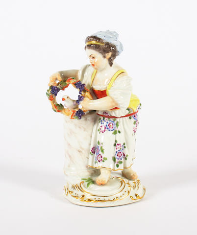 A Meissen figure of a girl with a dove Circa 1960-70.