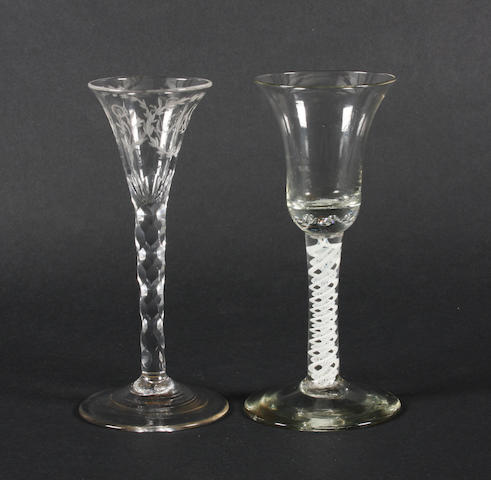 An engraved facet-stem wine glass and an opaque twist wine glass Circa 1790-1820 and circa 1770.