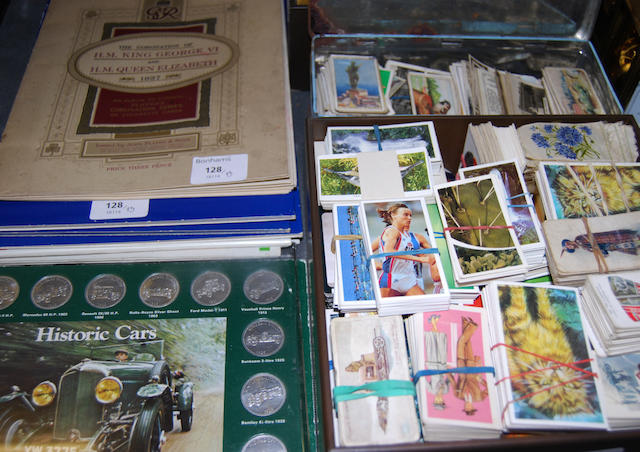 A large collection of cigarette cards and commemorative collector's coins