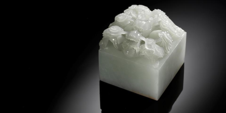 An important Imperial white jade 'Zi Qiang Bu Xi' seal Qianlong