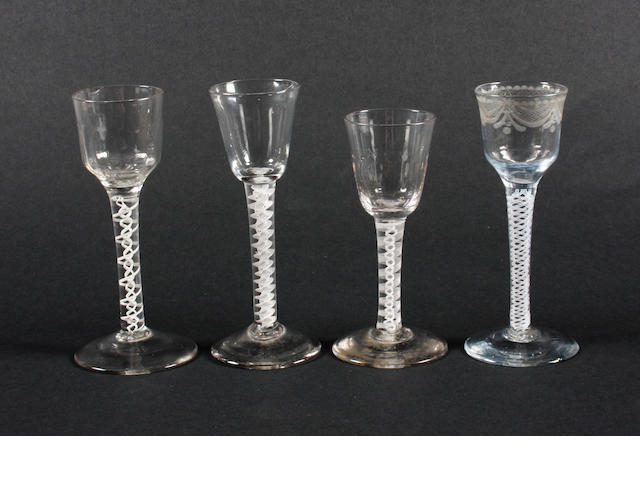 Four opaque-twist wine glasses Circa 1760.