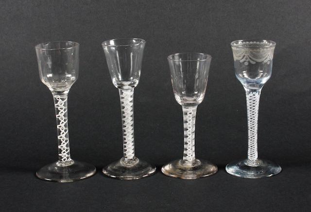 Four opaque-twist wine glasses Circa 1760.