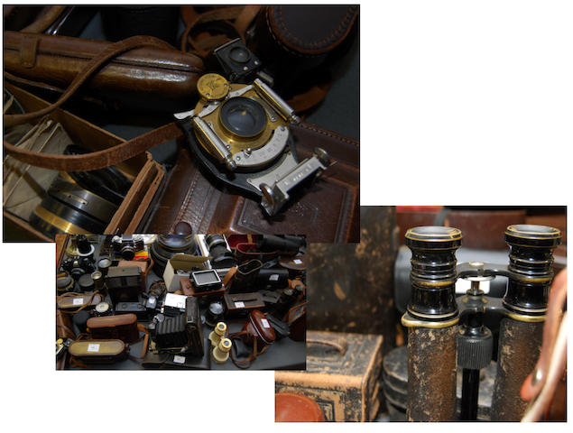 A large quantity of cameras, binoculars, and spares