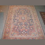 A Kashan rug Central Persia, 6 ft 10 in x 4 ft 3 in (209 x 130 cm) some wear and old moth damage