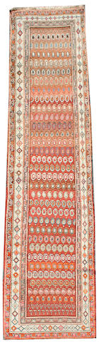 A North West Persian runner 13 ft 6 in x 3 ft 2 in (409 x 94 cm)