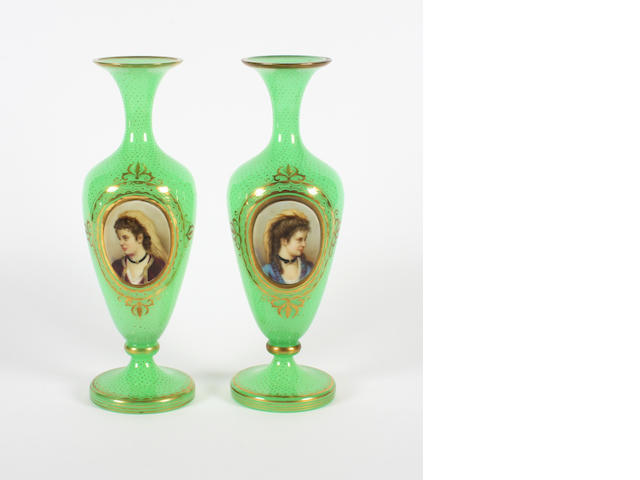 A pair of green opaline glass vases